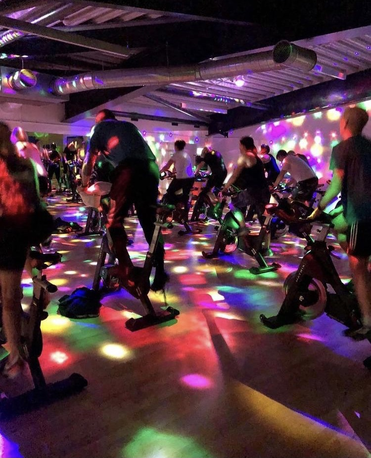 People riding exercise bikes
